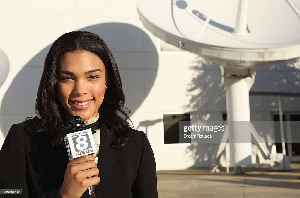 Woman reporting the news.  : Stock Photo