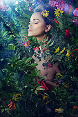 woman resting amongst many wild flowers