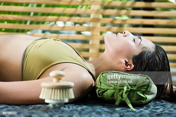 Woman resting at the poolside