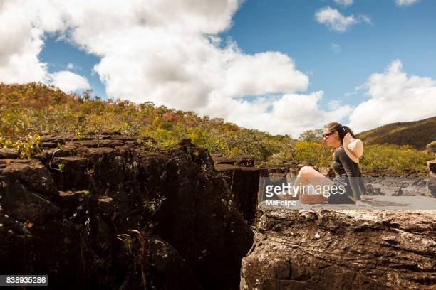 Woman resting at the top of canion