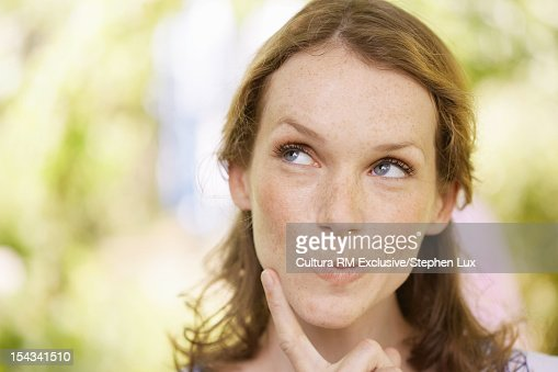 Woman resting chin on finger