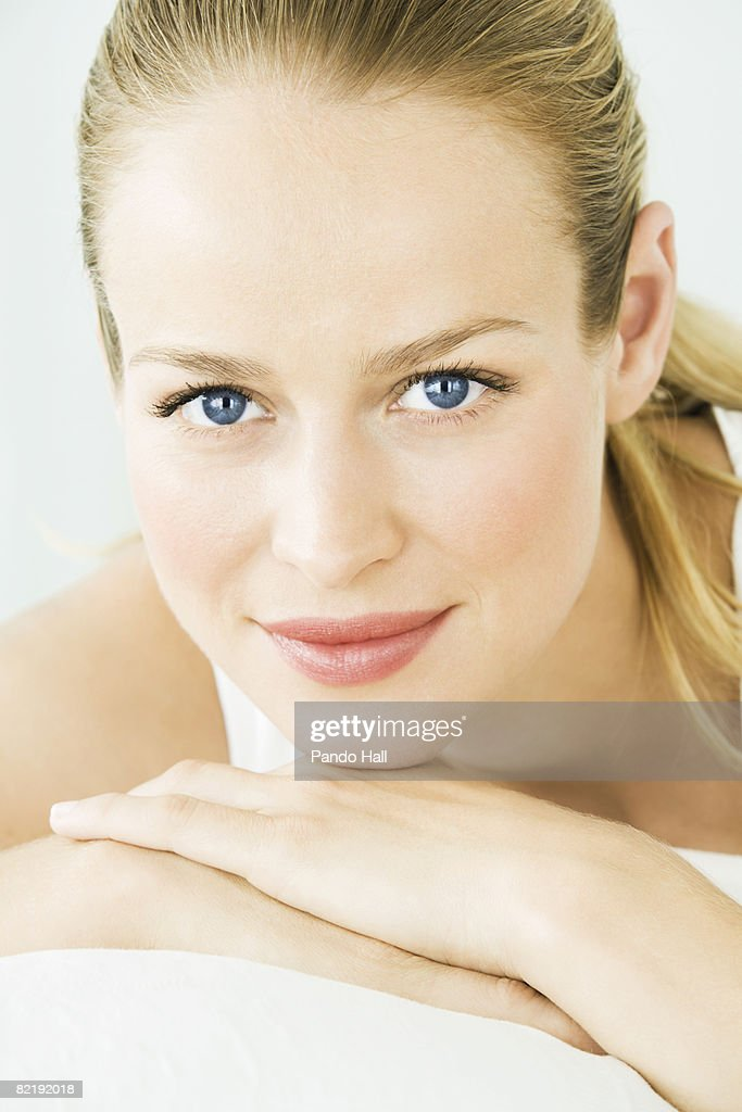 Woman resting chin on hands, portrait : Stock Photo