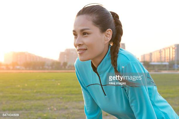 Woman resting during jogging