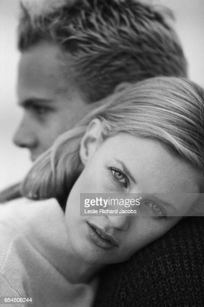 Woman Resting Head on Man's Shoulder