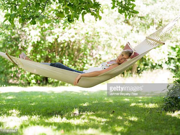 A woman resting in a hammock Stockholm Sweden.