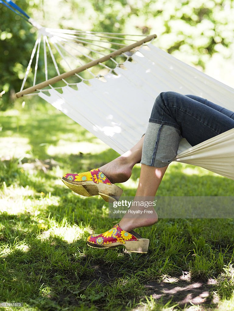 Woman resting in a hammock Stockholm Sweden. : Stock Photo
