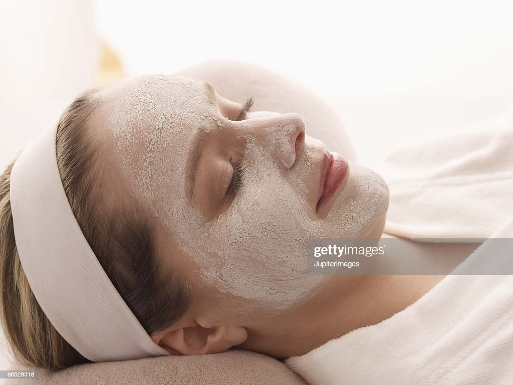 Woman resting in facial mask