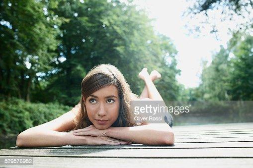 Woman Resting on Dock : Stockfoto