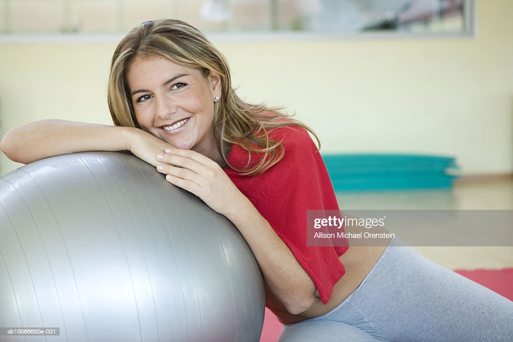 Woman resting on fitness ball : Stock Photo