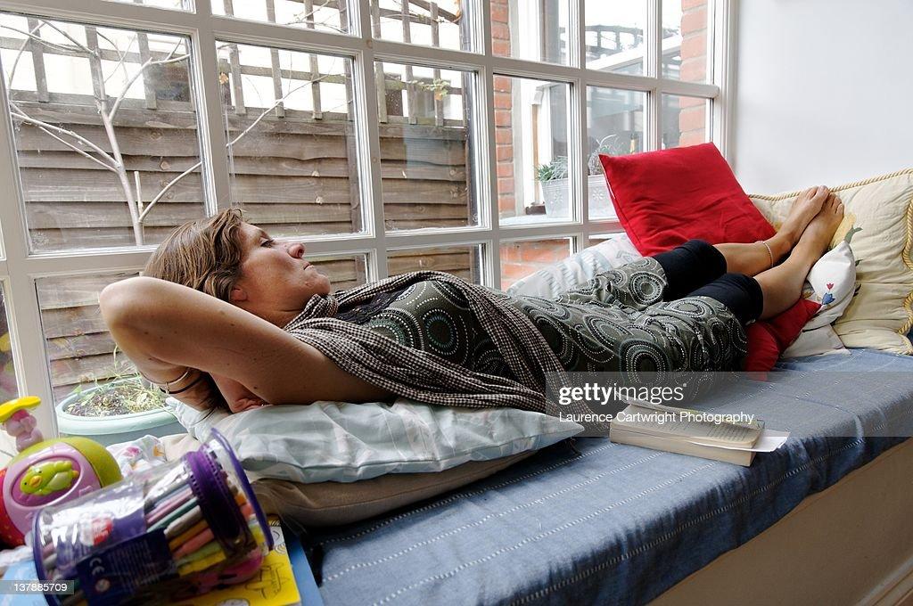 Woman resting on window seat