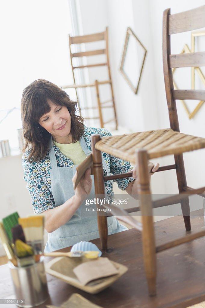 Woman restoring antique furniture, Jersey City, New Jersey, USA