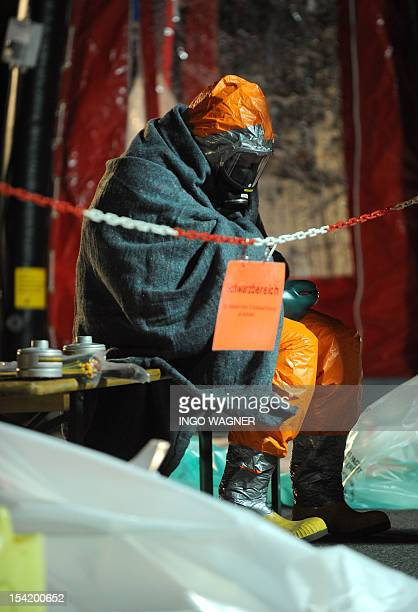 A woman rests after an accident at Kraft Foods in Bad Fallingbostel northern Germany on October 16 2012 Catastrophe alarm was sparked out when a tank...