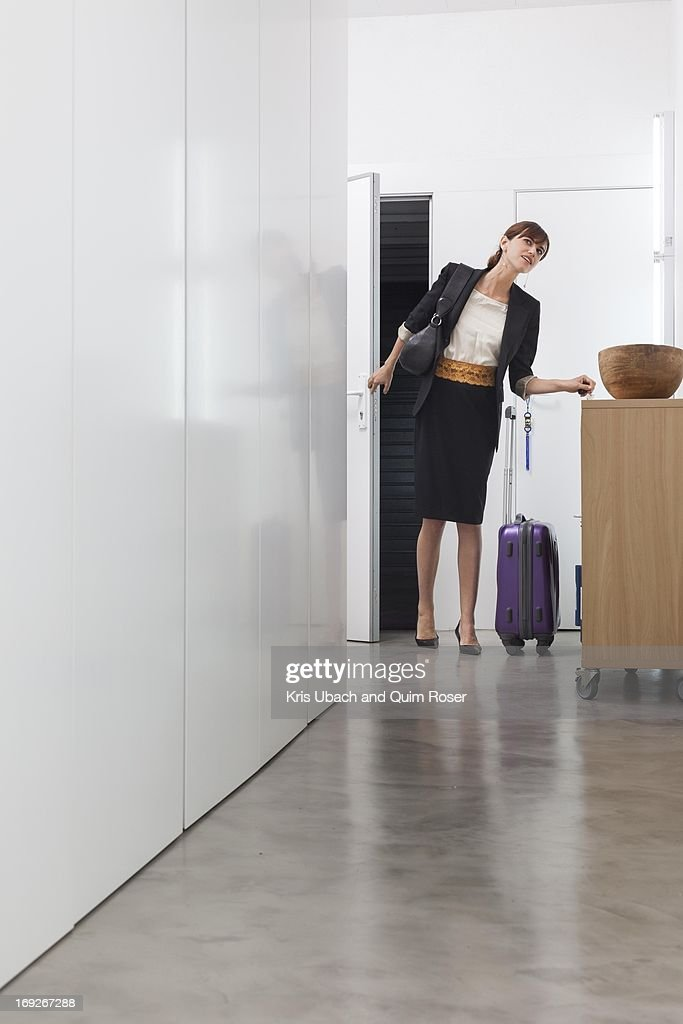 Woman returning from business trip