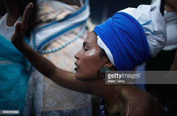 A woman reveres during Carnival celebrations at a 'bloco' or street parade on February 8 2016 in Rio de Janeiro Brazil Festivities have continued...