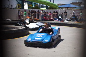 A woman rides a gokart at Breakwater Beach on the first weekend of Jersey Shore beaches reopening to the public on May 27 2013 in Seaside Heights New...