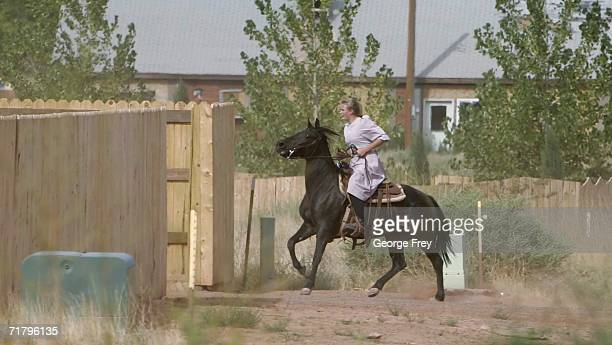 A woman rides a horse September 6 2006 in Colorado City Arizona Warren Jeffs of the Fundamentalist Church of Jesus Christ of Latter Day Saints is the...
