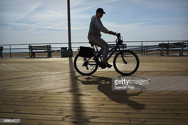 A woman rides along newly repaired boardwalk in Asbury Park before President Barack Obama spoke on May 28 2013 in Asbury Park New Jersey Seven months...