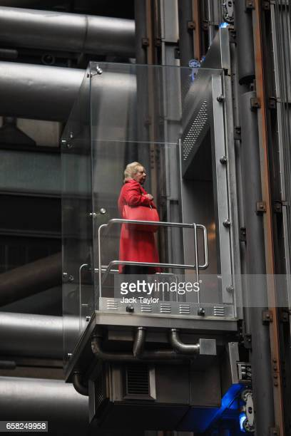 A woman rides an elevator in the Lloyd's building home of the world's largest insurance market Lloyd's of London on March 27 2017 in London England...