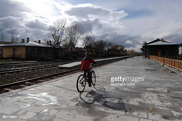CHEVIRON A woman rides her bike on April 16 2009 at the last train station between Turkey and Armenia in Kars on April 16 2009 While Ankara and...