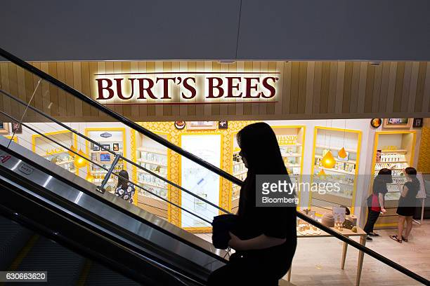 A woman rides on an escalator in front of a Burt's Bees Inc store a subsidiary of Clorax Co in Seoul South Korea on Thursday July 2 2015 At a time...