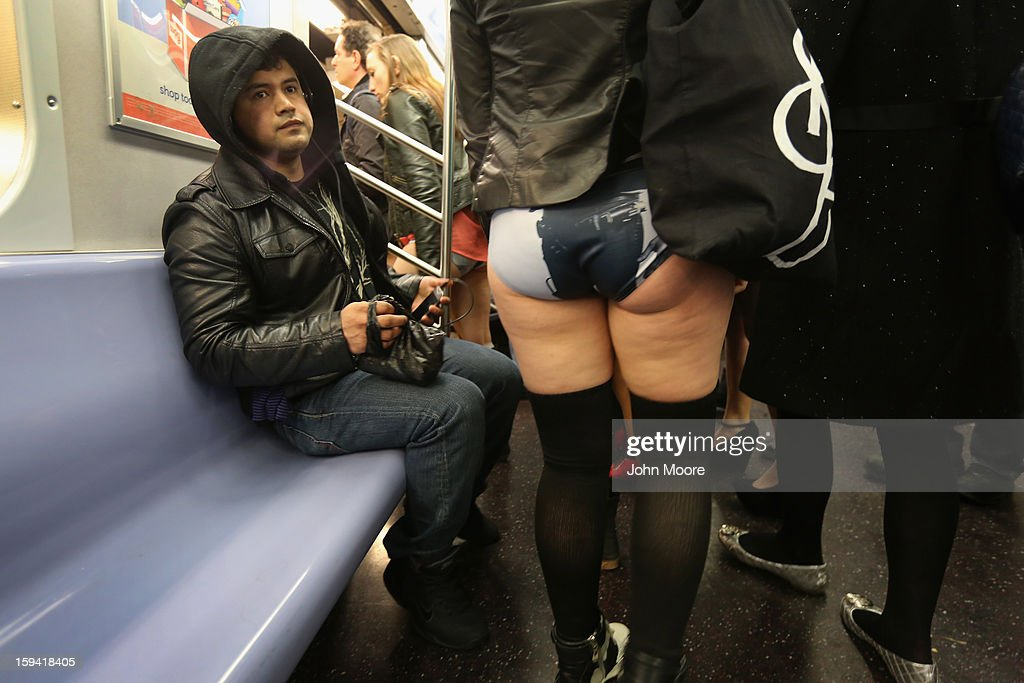 A woman rides the subway pantless on January 13, 2013 in New York City. Thousands of people participated in the 12th annual No Pants Subway Ride, organized by New York City prank collective Improv Everywhere. During the afternoon winter event, participants boarded separate subway stops and removed their pants, pretending that they did not know each other. The event, refered to as a 'celebration of silliness' is designed to make fellow subway riders laugh and smile.
