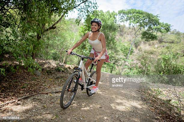 Woman riding a bicycle up in the mountains