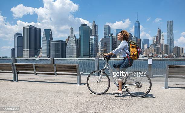 Woman riding a bike in NYC