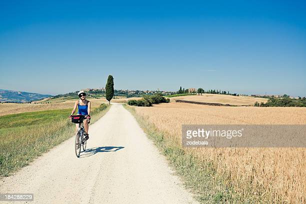 Woman Riding a Bike in the Countryside, Tuscany