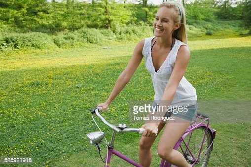 Woman Riding a Bike : Bildbanksbilder
