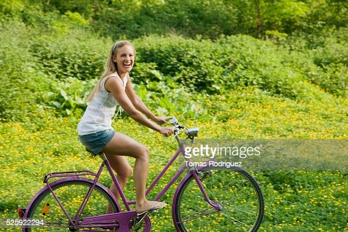 Woman Riding a Bike : Foto de stock