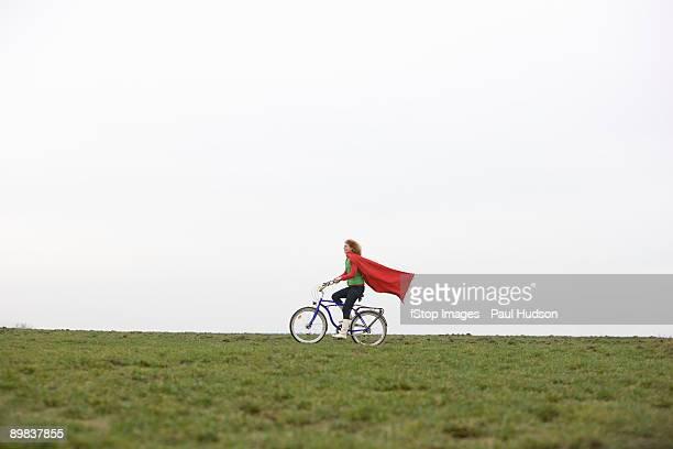 A woman riding a bike through a park