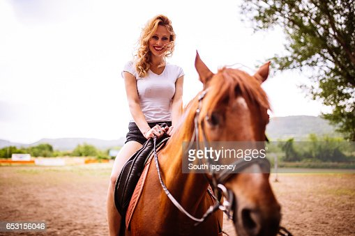 Woman riding a horse : Stock Photo