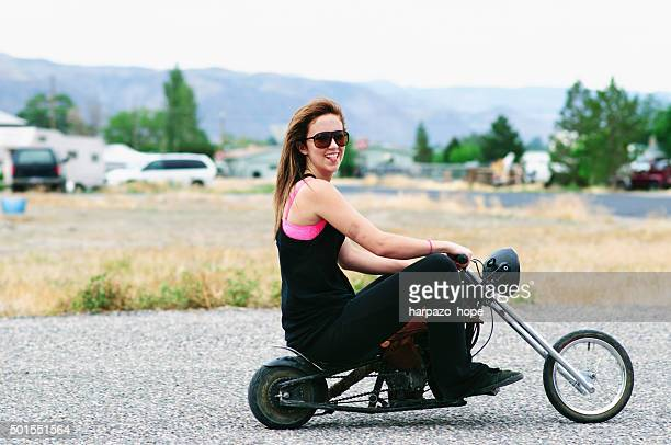 Woman Riding a Mini Motorcycle