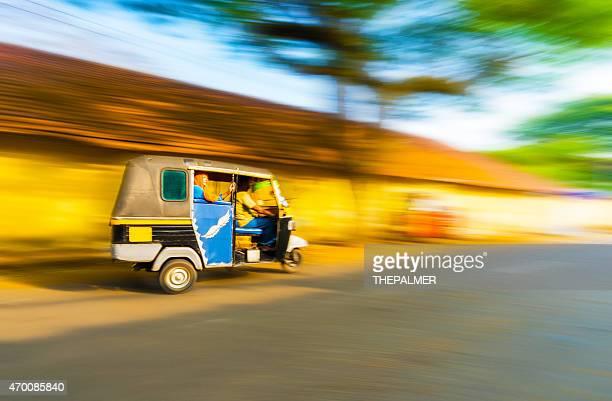 Woman riding a tuk tuk taxi