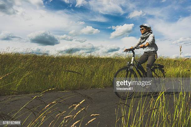 Woman riding bicycle in nature
