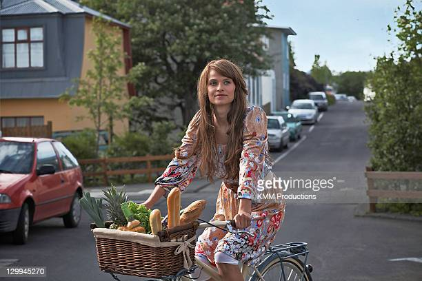 Woman riding bicycle in town