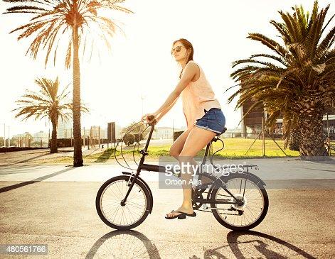 Woman riding bicycle : Stock Photo