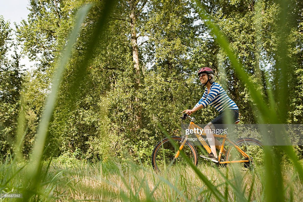 Woman riding bicycle : Stock Photo