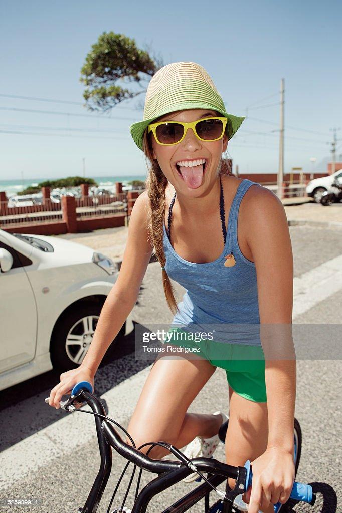 Woman riding bike : Stock-Foto