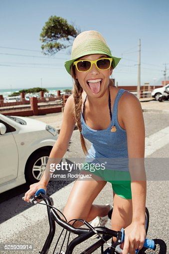 Woman riding bike : Stock Photo