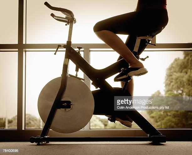 Woman riding exercise bike