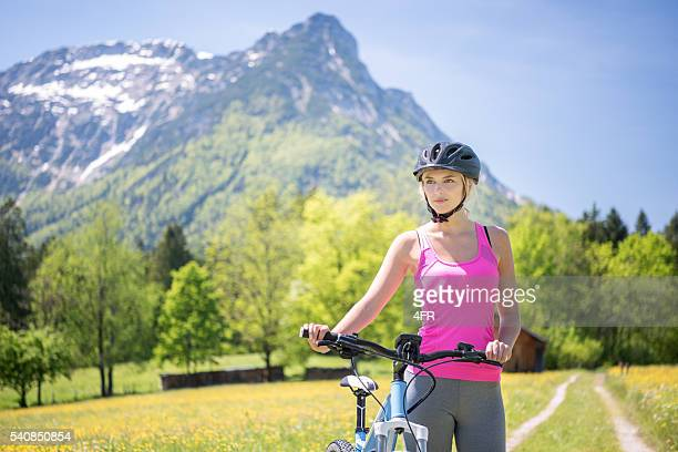 Woman riding her Mountainbike on a Trail, Austrian Alps
