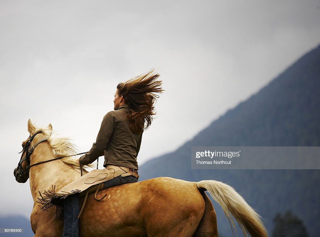 Woman riding horse bareback