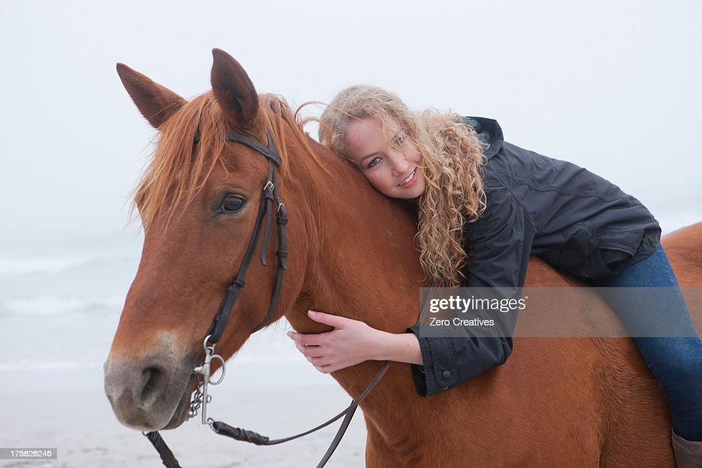 Woman riding horse on beach : Stock Photo