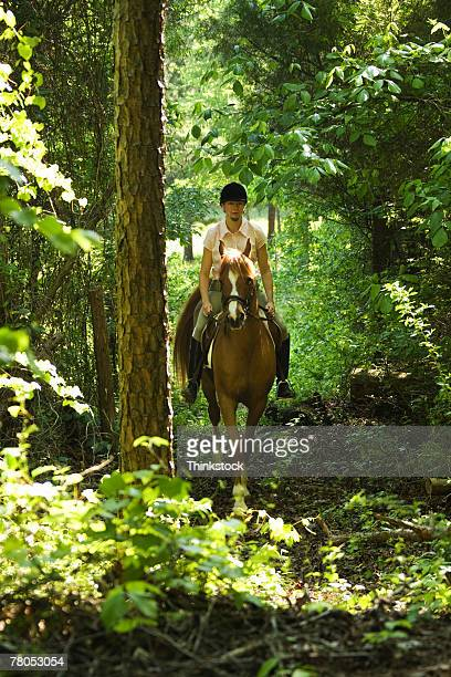 Woman riding horse