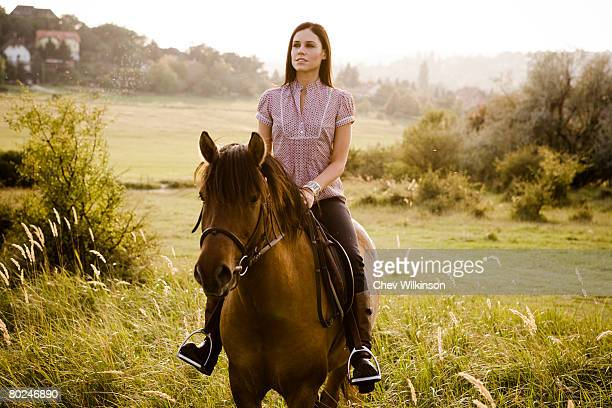 Woman riding horse.
