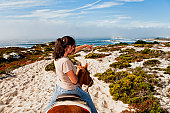 Woman riding horseback along Pebble Beach Equestrian Trail.