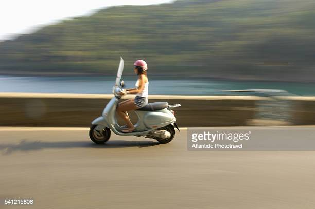 Woman Riding Motor Scooter