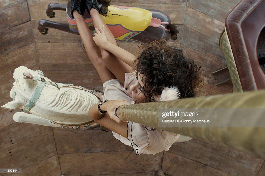 Woman riding on carousel : Stock Photo