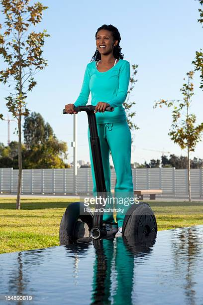 Woman riding on segway.